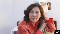被打致残的维权律师倪玉兰资料照