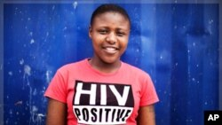 Nandi Makhele, 25, poses for a portrait while wearing a T-shirt indicating that she is HIV-positive, in Cape Town's Khayelitsha township February 15, 2010.