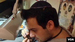 Yoni Davidov, a jeweler, says that his Jewish faith teaches that life's challenges, as well as life's pleasures and joys are equally gifts from God. (Adam Phillips/VOA)