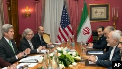 U.S. Secretary of State John Kerry, left, holds a meeting with Iran's Foreign Minister Mohammad Javad Zarif, right, over Iran's nuclear program in Lausanne, Switzerland, Tuesday, March 17, 2015.