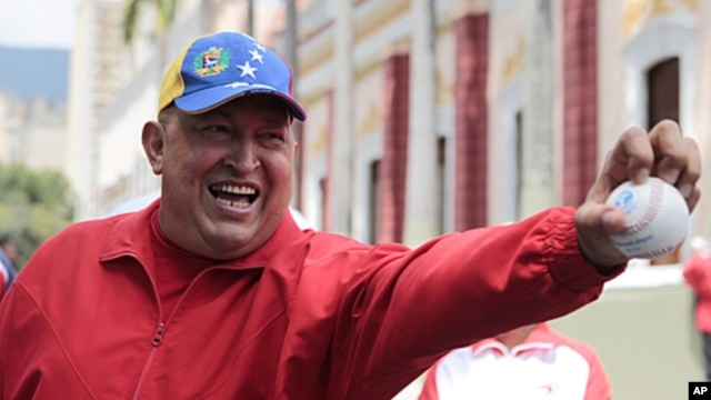 In this photo released by Miraflores Press Office, Venezuela's President Hugo Chavez jokes with a baseball at Miraflores presidential palace in Caracas, Venezuela, September 29, 2011.