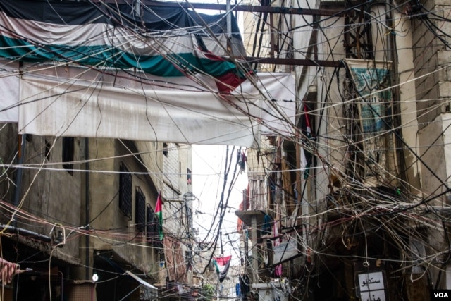 The streets of Shatila, where rates of poverty are high. It is one of twelve Palestinian refugee camps around Lebanon. (John Owens/VOA)