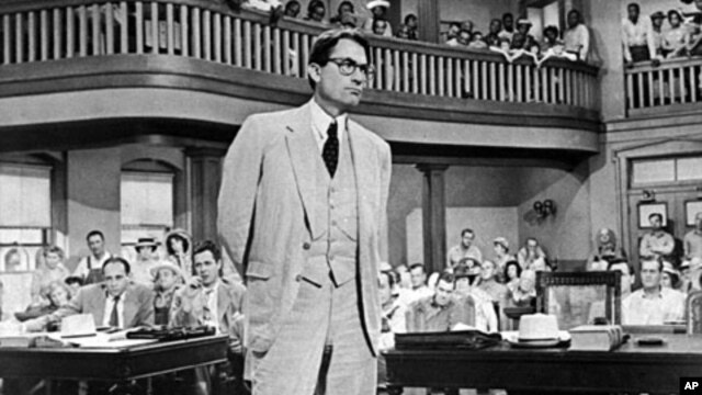 "FILE - Gregory Peck as attorney Atticus Finch, a small-town Southern lawyer who defends a black man accused of rape, in a scene from the 1962 movie ""To Kill a Mockingbird."""
