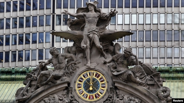 The clock on the south facing side of New York's Grand Central Terminal strikes noon March 29, 2012.