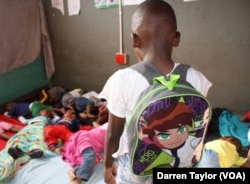 A little boy who'd been raped observes sleeping classmates at his crèche in Diepsloot, a violent Johannesburg settlement.