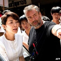 Michelle Yeoh and director Luc Besson on the set of 'The Lady'