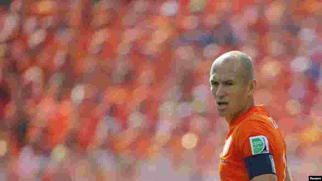 Arjen Robben of the Netherlands against the backdrop of a sea of Netherlands fans during the match against Chile at the Corinthians arena in Sao Paulo, June 23, 2014.