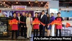 Employees and officials with PJ's Coffee of New Orleans at the ribbon-cutting ceremony last month for the company's first coffee shop in Vietnam.