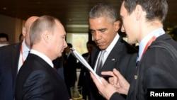 Ketegangan antara Presiden Rusia Vladimir Putin (kiri) dan Presiden AS Barack Obama tampak jelas sejak KTT APEC di Beijing, China (11/11).