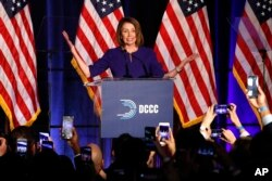 House Minority Leader Nancy Pelosi of Calif., smiles as she is cheered by a crowd of Democratic supporters during an election night returns event at the Hyatt Regency Hotel, on Tuesday, Nov. 6, 2018, in Washington.