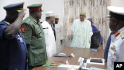 Nigerian President Muhammadu Buhari presides at a meeting with his nation's service chiefs in Abuja, June 2, 2015. (AP Photo/Bayo Omoboriowo)