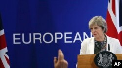 British Prime Minister Theresa May speaks during a media conference at an EU summit in Brussels, Oct. 20, 2017. European Union leaders gathered Friday to weigh progress in negotiations on Britain's departure.