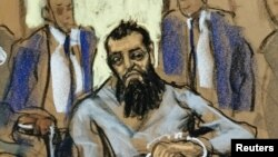 FILE - Sayfullo Saipov, the suspect in the New York truck attack, is seen in this courtroom sketch appearing in Manhattan federal courtroom in a wheelchair in New York, Nov. 1, 2017.