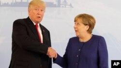 Дональд Трамп і Анґела Меркель у Гамбурзі, 6 липня 2017.