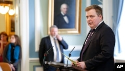 Iceland's Prime Minister Sigmundur Gunnlaugsson speaks during a parliamentary session in Reykjavik on Monday April 4, 2016. He resigned Tuesday after documents leaked in a media investigation allegedly link him to an offshore company. (AP Photo/Brynjar Gunnarsson)