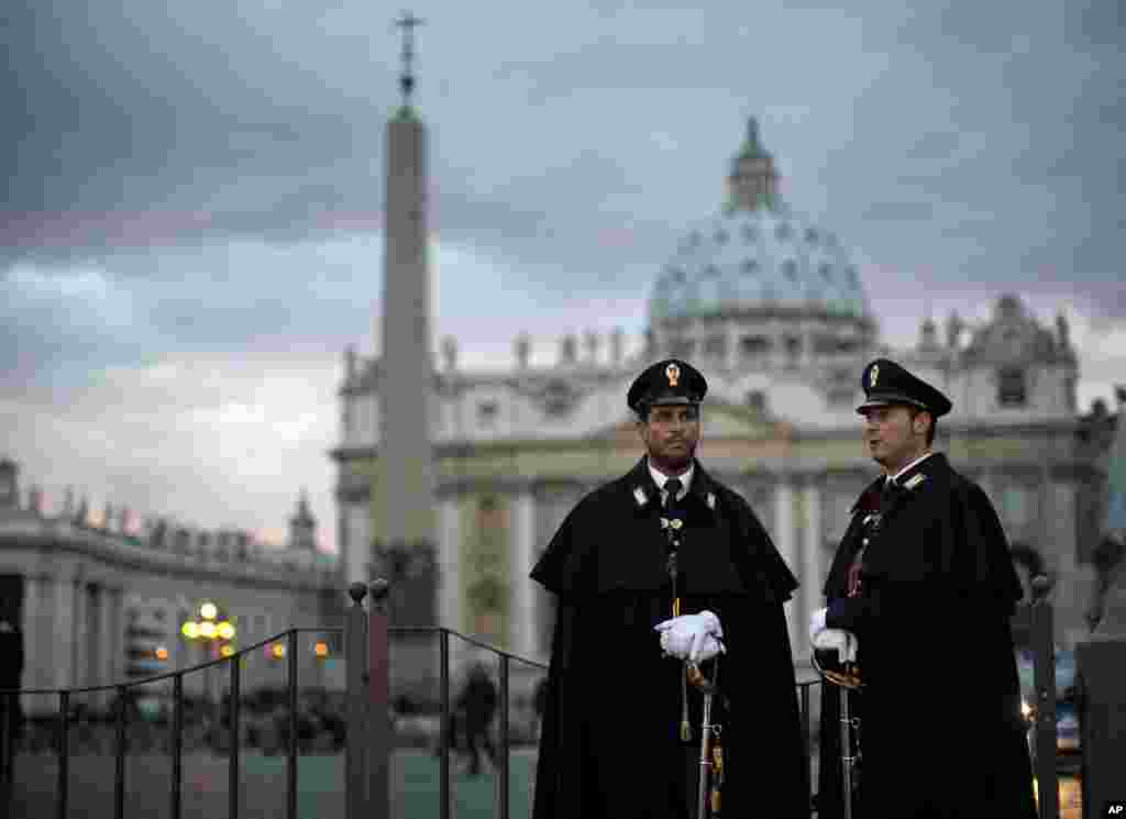 Police officers are seen outside Saint Peter's Square, March 11, 2013.