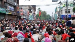Thousands of Maoist supporters rally in what is normally one of Kathmandu's busiest streets near the government center, 05 May 2020