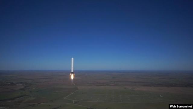 SpaceX's Grasshopper reusable rocket is seen flying over McGregor, Texas.