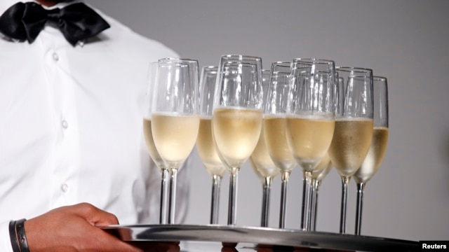 A traditional way to welcome the New Year is to drink a glass of champagne and kiss the person you love.