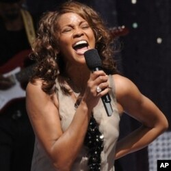 Singer Whitney Houston performs on the television program 'Good Morning America' in New York's Central Park, Sept. 1, 2009.