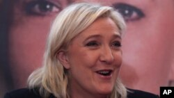 French far-right leader and National Front Party, Marine Le Pen, addresses the media during a news conference, Dec. 7, 2015, in Lille. France's far-right National Front ran strongly in a first-round regional vote that was the first election since an attack by Islamic extremists left 130 dead in Paris.