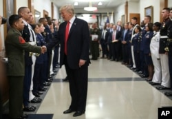 President Donald Trump greets military personnel during his visit to the Pentagon, July 20, 2017.