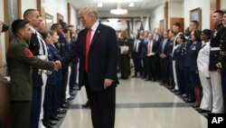 FILE - President Donald Trump greets military personnel during his visit to the Pentagon, July 20, 2017. (AP Photo/Pablo Martinez Monsivais)