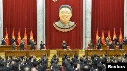 North Korean leader Kim Jong Un (C) supervises a meeting of the Central Committee of the Workers' Party of Korea, under a portrait of his father, Kim Jong Il, in Pyongyang. The photo was released on February 18, 2015 by North Korea's Korean Central News Agency (KCNA photo via REUTERS)