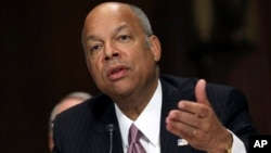 "FILE - Homeland Security Secretary Jeh Johnson testifies on Capitol Hill in Washington, April 28, 2015. Johnson said investigators have collected ""strong evidence"" leading to a prime suspect in the massive cybersecurity breach of Office of Personal Management."