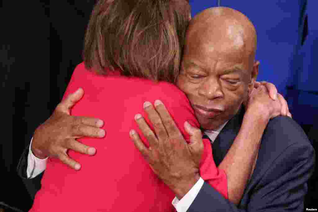 House Democratic leader Nancy Pelosi (D-CA) is embraced by U.S. Rep. John Lewis (D-GA) inside the House Chamber as the U.S. House of Representatives meets for the start of the 116th Congress on Capitol Hill in Washington, Jan. 3, 2019.