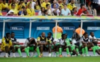 Nigerian players react on their bench after Nigeria's Joseph Yobo scored an own goal to give France a 2-0 victory during the World Cup round of 16 soccer match between France and Nigeria at the Estadio Nacional in Brasilia.