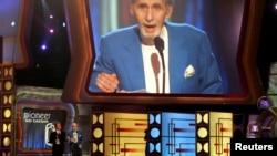 FILE - Legendary comedian Sid Caesar accepts the TV Land Pioneer award presented by friend and comedian Billy Crystal (L) during a taping of the TV Land awards show in Santa Monica, California, in 2006.
