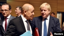 Britain's Foreign Secretary Boris Johnson talks with French Minister for Foreign Affairs Jean-Yves Le Drian during European Union foreign ministers meeting in Luxembourg, April 16, 2018.