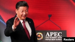 FILE- President of China Xi Jinping arrives for the APEC CEO Summit 2018 at Port Moresby, Papua New Guinea, Nov. 17, 2018.