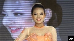 Nan Khin Zeyar presents a dress created by a local designer during the Miss Myanmar International Beauty Contest at Myanmar Convention Center (MCC) in yangon, Myanmar, on Sunday, March 25, 2012. Nan Khin Zeyar was crowned as Miss Myanmar later. (AP Photo/