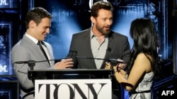NEW YORK, NY (L-R) Actors Jonathan Groff, Hugh Jackman and Lucy Liu speak onstage at the 2014 Tony Awards Nominations Ceremony at the Diamond Horseshoe at the Paramount Hotel, April 29, 2014 in New York City.