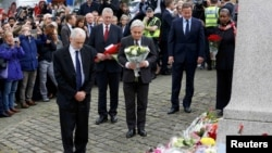 Britain's Prime Minister David Cameron, second from right, stands with Labour Party leader Jeremy Corbyn, left, John Bercow, Speaker of the House of Commons, center, and Labour MP Hilary Benn, second left, as they pay tribute near the scene where Labour Member of Parliament Jo Cox was killed in Birstall, near Leeds, June 17, 2016.