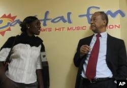 Capital FM owner Alaudin Osman and sub-editor Chikondi Juma in Blantyre, Malawi