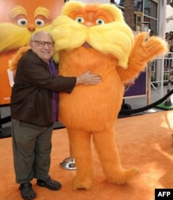 "Actor Danny DeVito and the Lorax arrive at the premiere of the animated feature film ""The Lorax"" in Universal City, California"