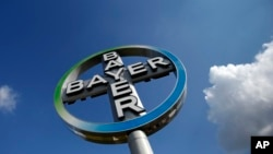 FILE - German drug and chemicals company Bayer AG has entered into talks with the Monsanto Company about possibly acquiring the U.S.-based specialist in genetically modified crop seeds.