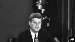 President John F. Kennedy makes a national television speech October 22, 1962, from Washington. He announced a naval blockade of Cuba until Soviet missiles are removed. (AP Photo)