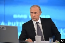During his annual call-in show with his nation, Russian President Vladimir Putin again denies having any Russian troops fighting in eastern Ukraine.