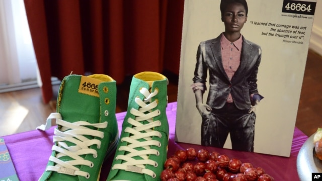Green casual shoes and a red beaded necklace on show at a fashion range launch, inspired by South African President Nelson Mandela's 94th birthday in Johannesburg, June 29, 2012.