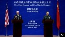 U.S. Joint Chiefs Chairman Gen. Martin Dempsey, left, speaks alongside Chinese counterpart Gen. Fang Fenghui, Bayi Building, Beijing, April 22, 2013.