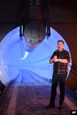 Elon Musk, co-founder and chief executive officer of Tesla Inc., speaks during an unveiling event for the Boring Company Hawthorne test tunnel in California on Dec. 18, 2018. (Robyn Beck/Pool Photo via AP)