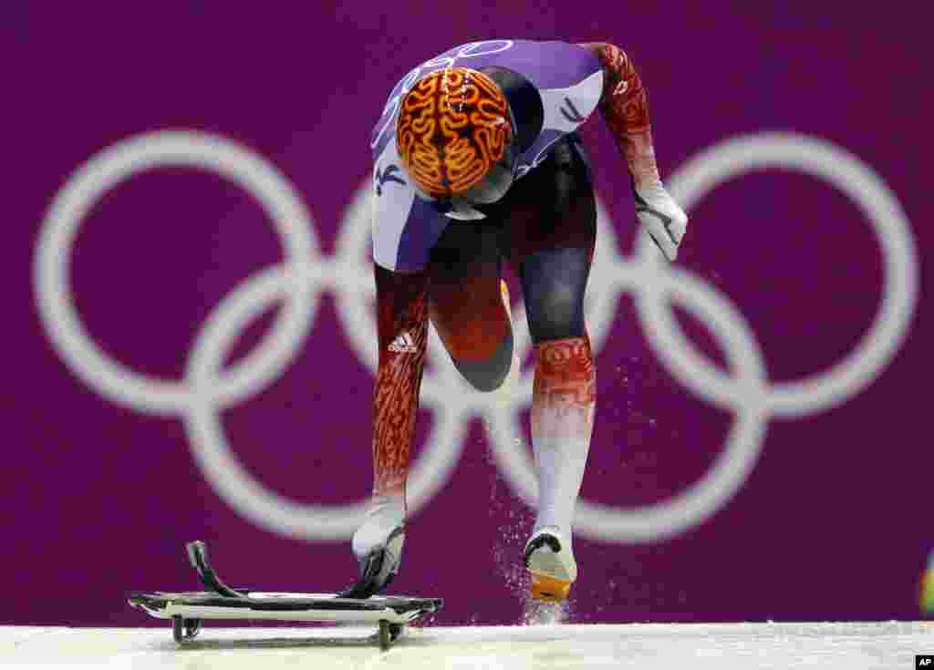 John Fairbairn of Canada starts a run during the men's skeleton training, Krasnaya Polyana, Russia, Feb. 11, 2014.
