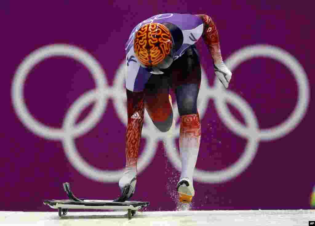 John Fairbairn of Canada starts a run during the men's skeleton training, Krasnaya Polyana, Russia,Feb. 11, 2014.