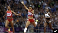 United States' Allyson Felix crosses the finish line to win the women's 200-meters final ahead of compatriot Carmelita Jeter, left, and Ivory Coast's Murielle Ahoure, at the 2012 Summer Olympics in London.