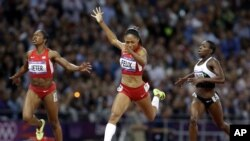 United States' Allyson Felix crosses the finish line to win the women's 200-meters final ahead of compatriot Carmelita Jeter, left, and Ivory Coast's Murielle Ahoure during the athletics in the Olympic Stadium at the 2012 Summer Olympics, London, Wednesd