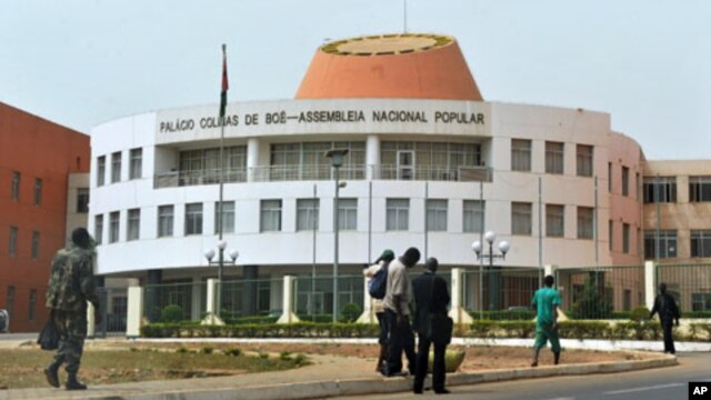 A picture taken on March 19, 2012 shows residents walking by the Parliament in Bissau.